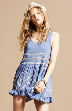 Fun and pretty! Love this Free People slipdress paired with a cute fedora and pendant necklace.
