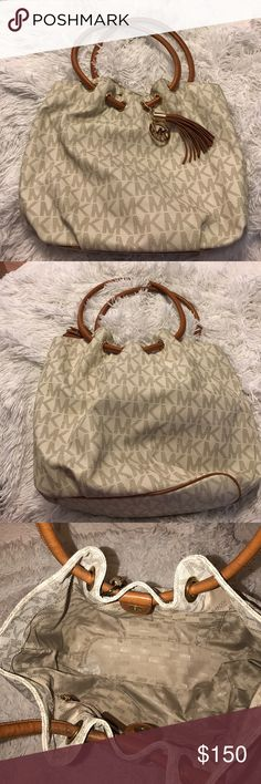 Michael Kors Leather Signature Tote Michael Kors Leather Signature MK Tote. Leather handles and tassel. Gold metal. Exterior and interior of bag in great shape. No scratches, markings, or stains. Used briefly, almost new. Michael Kors Bags Totes