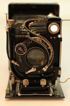 Artist Unzips Vintage Cameras to Reveal Their Inner Beauty - Hu Shaoming