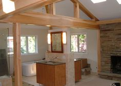 Simple bathroom setup with exposed wood rafter and beam
