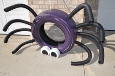 Halloween Tire Spider--My first tire recycling project! I spray painted the tire purple, had my husband drill eight holes for the 'legs' (made from wire and drainage tubing) and painted landscape bricks for the eyes. There is also a hole drilled in the top of the spider for a rope (in case the spider needs to hang from a 'web').
