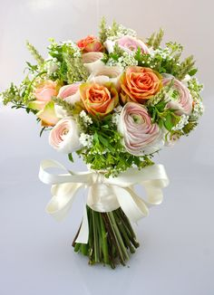 Bouquet Ranunculus Hanoi, Finesse Rose, Wheat, Spirea, with a hint of lilly of the valley - www.evelyncoleflowers.co.uk