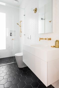 Home Interior Company Modern bathrooms call for sleek, contemporary finishes with a sophisticated edge. No better way to achieve a streamlined bathroom than with metro tiles from the floors to the walls and more. Here we share some of our favourite me. Bathroom Renos, White Bathroom, Bathroom Flooring, Bathroom Renovations, Small Bathroom, Master Bathroom, Modern Bathrooms, Black Bathroom Floor, Bathroom Faucets