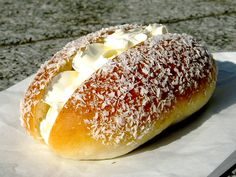 "Cream bun is a type of Chinese sweet bun. It is one of the most standard pastries in Hong Kong. It can also be found in most Chinatown bakery shops overseas. The bun has either butter cream or whipped cream filling down the middle with coconut sprinkles on the outside. Variations of it include the ""Cream Horn"", a pastry in a spiral shape, much like a horn, filled with cream."