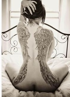 Impressive full back angel wings tattoo. So intricate! WOW. I love how it falls down the side of the hips!