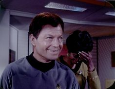 https://flic.kr/p/bPRGQ6 | Bridge Blooper, First Season, for McCoy and Uhura | A moment of laughter, as DeForest Kelly and Nichelle Nichols react to something funny, in this first season bridge shot blooper clip. The lighting makes me suspect this is from The Cormbomite Maneuver, but Uhura's gold uniform was worn in both Corbomite and Mudd's Women. Scanned and restored from the original Lincoln Enterprises 35mm film frame.   (Thanks to steersman3 below, for sure this is Corbomite Maneuver)