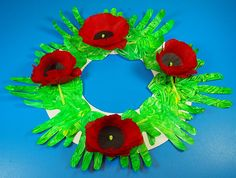 Use the poppies from our Remembrance Day Poppy kit to decorate your handmade Remembrance Day wreath! Everyone in your class can contribute to this activity using their hand-prints as leaves for the wreath!