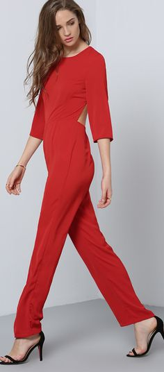 Keep it together in the Red Long Sleeve Backless Jumpsuit. This sophisticated piece features a classic rounded neck line, 3/4 length sleeves, and a dramatic back cut out. Pair with simple accessories to really make this jumpsuit pop!