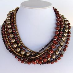 Example of a Statement Necklace made by Etherea Design. $120  Wear with solid top in black/brown/burgundy or gold. Also known as a 'bib' necklace. http://earthandmoondesign.com/shop/etherea/pinot-17-inch-multi-strand-pearl-necklace/