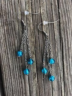 Earrings with chain and blue glass beads
