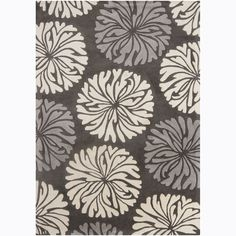 Geometric design highlights this Mandara rug. Hand-tufted in India using premium quality wool. Area rug features floral design in shades of grey and white against charcoal grey background.  Again, might work well on top of existing gray tiled carpet.