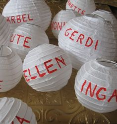 Mini paper lanterns with guests names.. used as placecards or a centerpiece. From the lovely Silke at The Crafts Dept.