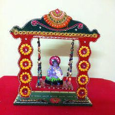 Pooja jhula crafted from wood with clay work online for How to make jhula at home
