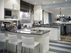 kitchen floor in gray and white stripes, transition to wood DR floor, white cabinets.  by Candace Olson Modern Kitchen Backsplash, Modern Kitchen Design, Kitchen Flooring, Backsplash Ideas, Kitchen Cabinets, Tile Ideas, Vinyl Flooring, Penny Flooring, Dark Flooring