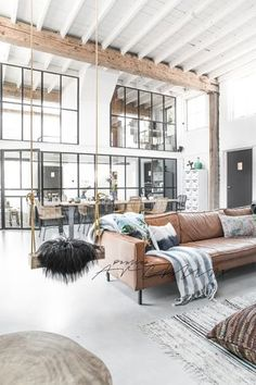 Soulful attic apartment in an old villa, the home of jewelry designer Charlotte Wendes. Absolutely love the wood beams & white staircase....via boligliv.dk