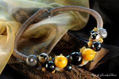 CYTRYNOWY UŚMIECH - kule ze szkła powlekanego w kolorze żółtym i czarnym - 280 PLN
