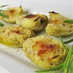 Artichoke hearts are topped with breadcrumbs and parmesan cheese and broiled, for a simple and satisfying appetizer.