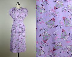 "1940s // Lavender Purple Musician Harpist Novelty Print Ruched Peplum Skirt Dress // ""Pennyroyal Tea"" // Size Small to Medium on Etsy, $138.00"