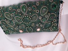 Green luxury evening embroidered women clutch named Ireland or Emerald Isle. Nature inspired. Unique design, one a kind. This unique fashion handbag suits for formal occasion, St.Patricks day, holiday party, Christmas etc. I have embroidered by hand this gorgeous handbag. It covered with green Japanese and Czech seed beads, Swarovski crystals and pearls, agate cabochons. Agate is beautiful stone it gives energy, creativity and happiness. It is known as the luck amulet and can restore harmony…