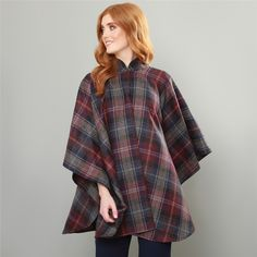A luxury one piece Donegal tweed cape. The fabric is a burgundy, blue & pink check, designed and woven in our mill in Donegal, Ireland. Style with the navy Fahan stretch trousers and white silk Darcy top.  Fabric – 100% pure new wool