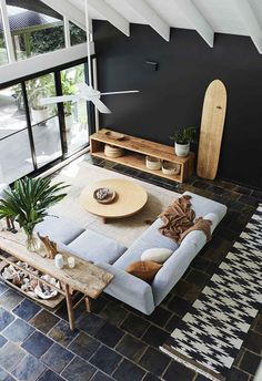 A creative couple tackled the renovation of their chalet style cabin house in Noosa with no expert help but plenty of determination. unit design Living Areas A chalet style house in Noosa was given a stunning renovation Living Tv, My Living Room, Living Area, Living Spaces, Barn Living, Modern Living, Black Feature Wall, Feature Walls, Light Blue Sofa