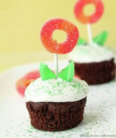 "Flower Pot Cupcakes: To create each edible floral display, frost a chocolate cupcake, then insert a lollipop stick you've pushed into a gummy ring. Green candies on either side of the ""stem"" mimic petals."