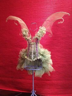 Tyler from our Lafayette store made this whimsical fairy from one of our wire dress forms, mesh, and floral stems.