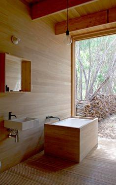 Beautiful wood wrap around tub.