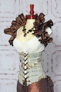 Steampunk costume ideas by fairlite2u. Who would have thought to make a corset with a newspaper print like that?! It's awesome.
