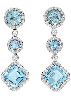 Favero Aquamarine & Diamond Dangle Earrings.  Favero Aquamarine & Diamond Dangle Earrings, set in 18Kt White Gold and feature 6 Mixed Cut Aquamarines for approximately 6.96cts accented by approximately 0.62cts of Round Brilliant Cut Diamonds. Earrings weigh 12.38 grams.