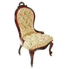Victorian Rosewood Lady's Chair   A 19th century Victorian rosewood upholstered lady's chair.  The chair has a shaped back with a scrolling acanthus carved decoration hand grip to the top.  The front legs are cabriole shaped with scroll carved detail and brass and pottery casters and the back legs are turned and shaped rosewood.  The chair is upholstered in a floral material with a button back seat.  The chair is in very good condition. (Circa 1860)  Height 99cm (39 inches) Width 54cm (21.3 inch Wingback Chair, Armchair, Antique Bedroom Furniture, Antique Chairs, Back Seat, Accent Chairs, Victorian, Carving, Acanthus