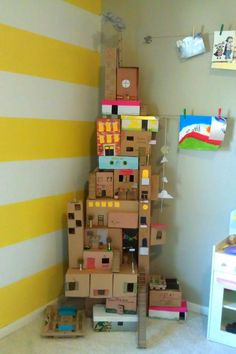 How cool is this little city highrise? My kids would love this with their action figures or even thier polly pockets. Save my shipping boxes and shoe boxes even oatmeal containers will do the trick.
