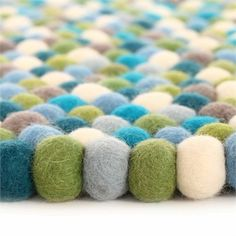 Create a playful and kid friendly room with the Blueberry Felt Ball Rug.  This adorable rug features a unique design that is perfect for nurseries, bedrooms and playrooms!