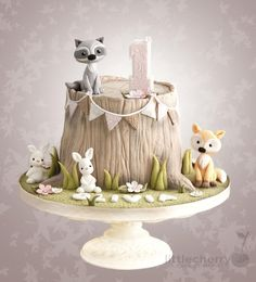 Woodland animal tree stump cake with fox, raccoon and bunnies - Cake by Little Cherry. This is adorable. Would be ideal for a woodland themed baby shower or birthday party.