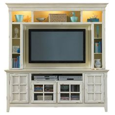 Anchor your den or living room with this handsome media center, showcasing a cream finish and ample storage for your entertainment needs.  ...