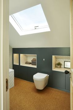 If you're designing a bathroom to suit a loft conversion and are looking to tackle an awkward space, consider building handy recesses into the eaves. # Loft conversions: 23 expert tips for getting it right Attic Shower, Small Attic Bathroom, Loft Bathroom, Upstairs Bathrooms, Bathroom Ideas, Loft Ensuite, Bathroom Vanities, Bathroom Renovations, Bathroom Storage