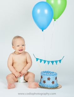 Super Cute little guy at his Smash the Cake Photo Session.  Photography done by www.codiophotography.com