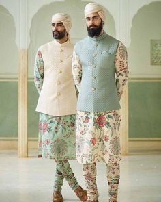 With wedding season around the corner, why stick to traditional plain kurta? Why not experiment something and get this absolutely stunning floral kurta-pajama with plain nehru jacket and be the star of the wedding? Mens Wedding Wear Indian, Wedding Kurta For Men, Mens Indian Wear, Wedding Dresses Men Indian, Indian Groom Wear, Wedding Dress Men, Indian Men Fashion, Latest Mens Fashion, Latest Fashion Clothes