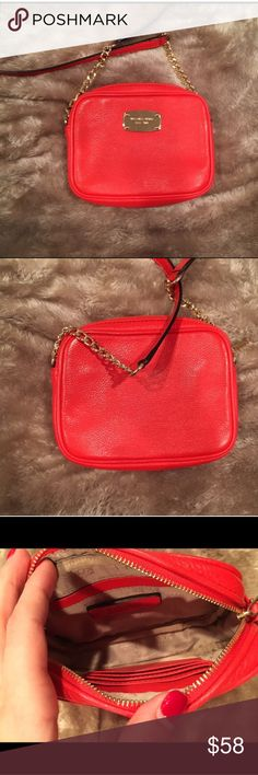 Red Michael Kors Crossbody! A coral red Michael Kors Crossbody! Better photos coming. Inside is shown, great for nights out and has a long strap to wear as a cross body or on one should like a regular handbag. Used a few times. Also sold on Merc. Michael Kors Bags Crossbody Bags