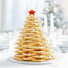 Cookie tree centerpiece...only mine had frosting icicles. I just drizzled each layer of frosting.  Scrumptious!