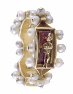 Renaissance Enamel Ring, mid-15th century, Franco-Netherlandish. Made in Burgundy. Gold, Pearls, ronde-bosse, and red enamel.