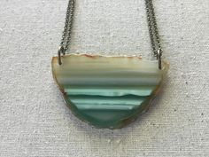 A personal favorite from my Etsy shop https://www.etsy.com/listing/279006620/hand-drilled-green-and-white-agate-slice