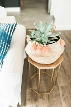 Woven pom pom accented planter: http://www.stylemepretty.com/living/2016/01/25/modern-bohemian-california-home-tour/ | Photography: Daphne Mae - http://www.daphnemaephotography.com/