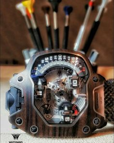 """URWERK  UR-110 EASTWOOD MACASSAR EBONY """"The beauty of the UR-110 is in its apparent simplicity. We imagined time as a 'silent journey'. There are things happening on the dial that are not obvious at first glance. Everything looks normal; however, they are everything but."""" MARTIN FREI."""