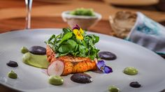 Barbacoa Style Fish. Josefina López Mendez, chef of the Chapulín restaurant in Mexico City paired Tequila Casa Dragones Joven with a fish cooked in adobo chiles and accompanied with avocados, radishes and watercress.