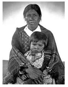 1888 photo of a Cherokee woman holding a child in her lap