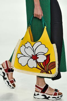 Pop-Art Blossoms These oversized, Crayola-colored flowers bloomed during a few major runway shows, and we love how they look pretty and feminine without being saccharine. Either embroidered (like Fendi) or leather patchwork (like Roland Mouret), these florals could also inspire your next weekend DIY; all you need is an old bag that could use some new verve. Marni