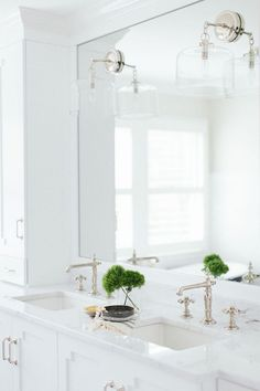 Bathroom Double Sink with Marble Countertop. White cabinet with Double Sink Bathroom. Bathroom Double Sink. #BathroomDoubleSink #DoubleSink Kate Marker Interiors.