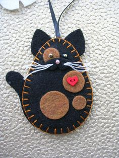 I WILL COMBINE SHIPPING/HANDLING CHARGES ON PURCHASE OF MORE THAN ONE ITEM. PLEASE CONTACT ME FOR DETAILS. This charming tortoiseshell kitty cat measures approx. 4 high x 3 1/2 wide. It is hand cut and sewn and lightly padded with fiberfill. The cats listed are my own design and are an