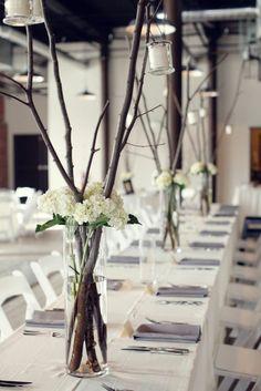 Hochzeitstischdeko tree branches white flowers